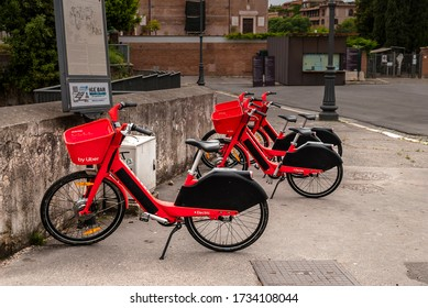 Rome, Italy 05 16 2020: Uber red bikes for bike sharing in Rome. Alternative means of getting around the city of Rome