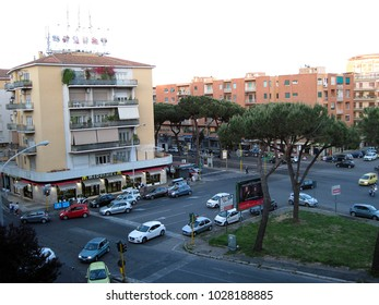 ROME, ROME, ITALY, 05/10/2015, A VIEW OF APARTMENT BUILDINGS, RESTAURANTS WITH CARS AND PEOPLE MOVING AROUND ON THE STREET OF ROME, ITALY