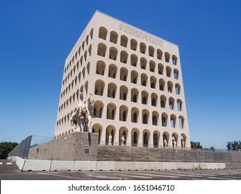 Rome / Italy -06 16 2019: Palazzo della Civiltà del Lavoro Italiana or Colosseo Quadrato (Square Colosseum). Massive building of Fascist architecture in EUR district in Rome, is a symbol of fascism.