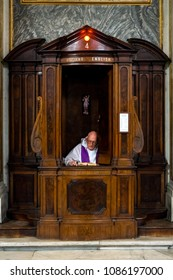 Rome, Italy, 07/04/2017, a priest waits in the confessional for the next penitent
