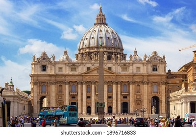 Rome, Italy - 08.20.2014: Tourists on the St. Peter's Square, architectural masterpiece with Michelangelo's dome in Vatican City, Rome. Famous Italian landmark