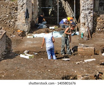 Rome, Italy -09-19-2011: Young people or students are excavating on an archaeological site near Colosseum in September.