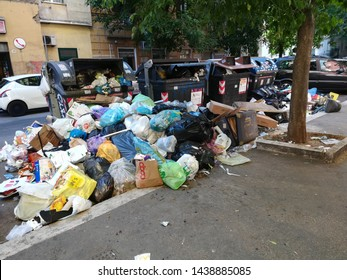 Rome, Italy - 1 July 2019: Waste emergency and transport in the capital, garbage on the ground near the bins in Via della Marranella