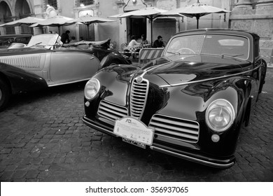 Rome, Italy - 1 October, 2005: Antique limousine car show with classic Alpha Romeo car in the foreground