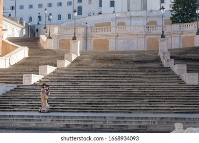 ROME, ITALY - 10 March 2020: Two female tourists take a selfie in front of the empty Spanish Steps, Rome, Italy.  Tourism has collapsed as a result of the covid-19 epidemic.