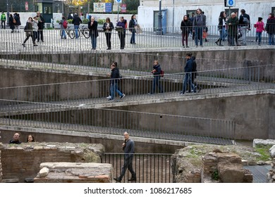 Rome, Italy, 11/19/2017: tourists walking in Rome on a zig-zag walkway curiously observe what is in front of them.