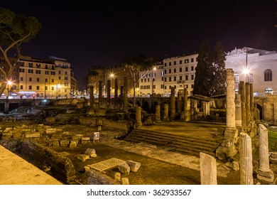ROME, ITALY - 11TH MARCH 2015: Largo di Torre Argentina ruins in central Rome at night with buildings in the distant,.