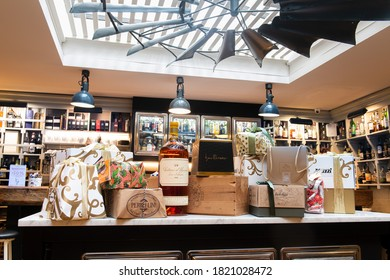Rome, Italy, 12 december 2019. Abundance of Christmas sweet cakes panettone, wine and boxes on table in wine bar store
