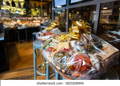 Rome, Italy, 12 december 2019. Big Christmas basket full of luxury food and drink delicatessen for sale in grocery store