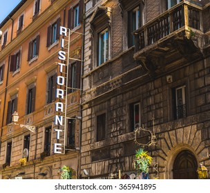 ROME, ITALY - 12TH MARCH 2015: The outside of a Restaurant in Rome during the day with a big Ristorante sign.