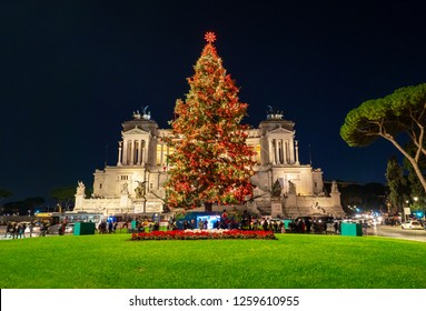 Rome, Italy - 15 December 2018 - Piazza Venezia square in blue hour during the Christmas holiday, with lights decorations and Christmas tree named Spelacchio