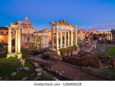 Rome, Italy - 15 December 2018 - The archeological ruins of Rome's historic center, named Imperial Fora, in the night. Here the Trajan's Market ruins.