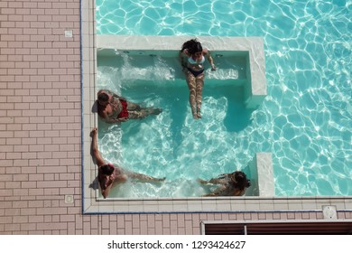 ROME , ITALY 17 JULY 2018 : spa in jacuzzi. people are relaxing at the poolside. relaxing in swimming pool spa. people is relaxing in the pool.Relax spa.