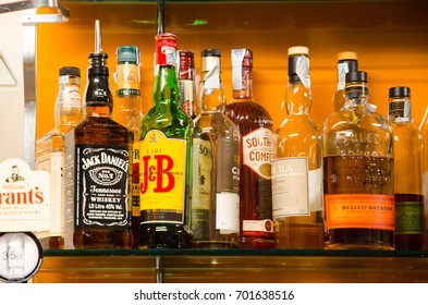Rome, Italy. 19 august, 2017. Colored liquor bottles and various brands in a pub in Rome
