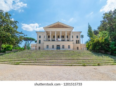 Rome, Italy - 19 August 2018 - A view of Villa Torlonia, public park of Rome with fountains, neoclassical buildings, museum and surrounding gardens, formerly belonging to the Torlonia family.