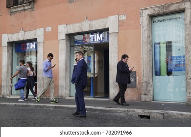 ROME, ITALY - 19 SEPTEMBER 2017: Pedestrians walk past of tim store in downtown Rome, Italy.