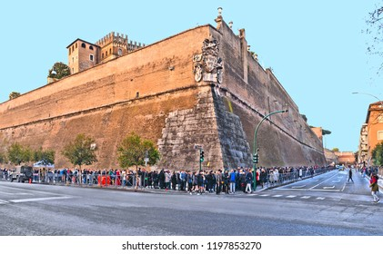 Rome, Italy, 20.02.2018. People in infinity row for entrance on the footpath beside the enormous wall surrounding a section of the Vatican City, Rome, Italy