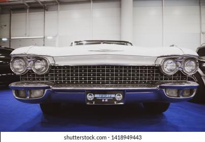 Rome, Italy, 2019 april 26. American cars exhibit. White vintage Cadillac Eldorado front view close up