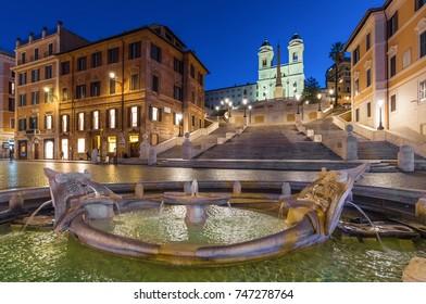 ROME, ITALY - 27 OCTOBER 2017 - The Piazza di Spagna square at the dawn in blue hour, with Trinità dei Monti stairs and the Fontana della Barcaccia fountain
