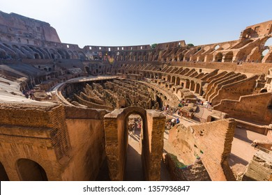 ROME, ITALY - 28 AUG 2017: The central oval arena of the ancient roman coliseum, with tiered terraces at sunrise, in Rome, Italy,