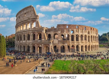 Rome, Italy - 3 December 2019 - The archeological ruins in historic center of Rome, named Imperial Fora. Here the awesome roman amphitheatre named Colosseum (Colosseo in italian language)