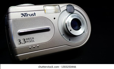 Rome, Italy: 30 January 2019: Vintage digital camera of the TRUST company with 3.3 mega pixel sensor. dark background. concept for technological obsolescence