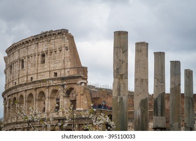 Rome, Italy - 4 April 2015:  View of tourist visiting the Roman Colosseum with Roman columns seen in the foreground.