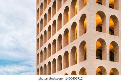 Rome, Italy - 6/15/2019: Close-up of the facade of the Palazzo della Civiltà Italiana, also called Squared Colosseum, in Rome in the EUR district, with arches and columns, neoclassical design in stone