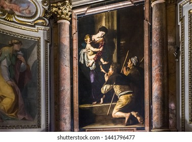 Rome, Italy - 6/28/2019: Madonna dei Pellegrini, picture painting and work of art by Caravaggio, Michelangelo Merisi, Cappella Cavalletti of the Basilica of Sant'Agostino