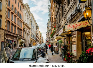 Rome, Italy - 8 February 2016: Streets of Rome with people engaging in daily activity.