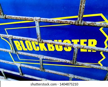 Rome, Italy - April 02, 2019:BLOCKBUSTERS showcase with rusty closed shutter. US distribution company, founded by David Cook in 1985 and bankrupt in 2013. focused on the rental purchase of home video