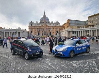 ROME, ITALY. April 08, 2018: Two cars of Italian security. Carabinieri and Police in front of the Vatican City in Rome. In St. Peter's Square. Italy. Many faithful present by visiting.