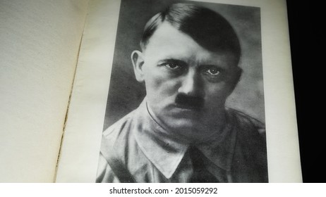 Rome, Italy - April 10, 2021, detail of an image of Hitler in the book with the title My battle, Italian translation of Adolf Hitler's Mein Kampf, at the behest of Mussolini.