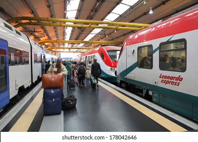 ROME, ITALY - APRIL 11, 2012: Passengers hurry out of the trains at Fiumicino Airport in Rome. Italian railways Trenitalia are among largest companies in Italy with almost 40,000 employees (2010).