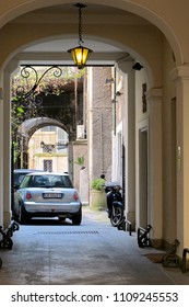 ROME, ITALY -APRIL 12, 2010: Mini Cooper car and Vespa motorbike parking in the beautiful alley