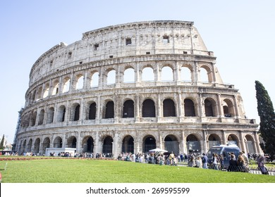 ROME, ITALY - APRIL 12: Wide view of the elliptical amphitheatre Colosseum, symbol of Roman Empire, on April, 12, 2015 in Rome, Italy. It was included among the New Seven Wonders of the World.