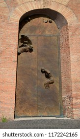 Rome, Italy, April 16, 2015. Sculptures on the door of the Basilica of St. Maria degli Angeli and dei Martiri