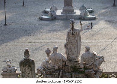 ROME, ITALY - APRIL 16, 2020: Deserted Piazza del Popolo in central Rome on April 16, 2020 during the lockdown aimed at curbing the spread of the COVID-19 infection, caused by the novel coronavirus.