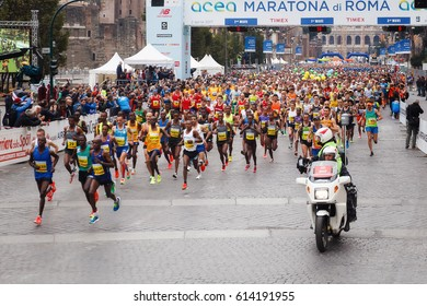 Rome, Italy - April 2, 2017: the departure of the athletes on Via dei Fori Imperiali, the Coliseum on background. In the foreground the Senegalese and Moroccan athletes