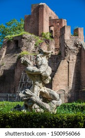 ROME, ITALY - APRIL, 2018: Statue and the ruins of the ancient monumental fountain called Trofei di Mario at Piazza Vittorio Emanuele II in Rome