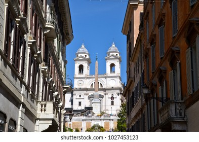 ROME, ITALY - APRIL 21, 2014: Trinita dei Monti Church on top of Spanish Steps in Rome Italy. With 138 steps in total the Spanish Steps of Rome are the longest and widest outdoor steps in Europe.