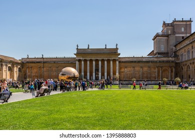 ROME, ITALY - APRIL 21, 2015: Outdoor front view of the Vatican Museum. Green lawn in the foreground, people and building in the background in Rome Italy April 21, 2015.