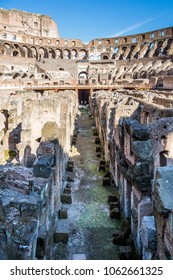 ROME, ITALY - APRIL 22, 2015: Vertical ground view of the center aisle inside the Colosseum in Rome April 22, 2015.