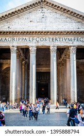 ROME, ITALY - APRIL 22, 2015: Vertical daytime view of people in front of the famous Pantheon building with tall columns in Rome Italy April 22, 2015.