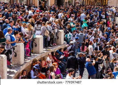 ROME, ITALY - APRIL 22, 2017: Tourists jam by world famous Trevi Fountain. Rome, Italy.