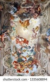 Rome, Italy - April 22, 2018: Painting Allegory of Divine Providence and Barberini Power is a fresco by Italian painter Pietro da Cortona, in the grand salon of the Palazzo Barberini from the 1600s