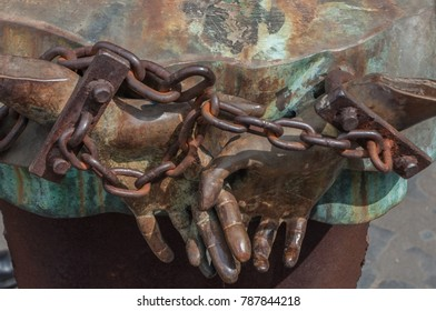 Rome, Italy - April 23, 2009 - Metal sculpture of human figures with hands chained by Mimmo Paladino is a monument to victims of the holocaust as well as all potential targets of fascism and racism.