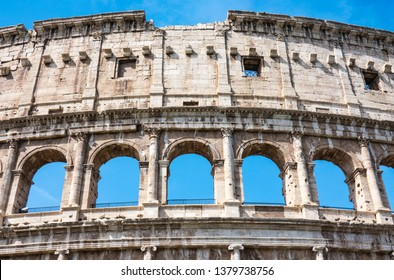 ROME, Italy- April 24, 2019: Great Roman Colosseum (Coliseum, Colosseo) also known as the Flavian Amphitheatre. Famous world landmark. Detail of the Arches.