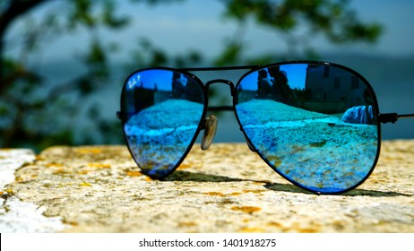 Rome, Italy - April 25, 2019: Ray-Ban polarized glasses on a wall with a blurred background. brand of sunglasses and eyeglasses designed for aviators by Bausch & Lomb