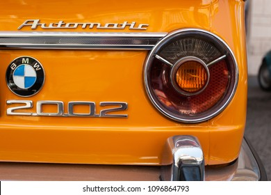 Rome, Italy - April 26 2018: Rearlight of an orange BMW 2002 Oldtimer Car